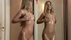 Slim blonde gets wet while touching herself in front of the camera