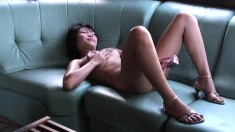 Uninhibited young babe strips and strokes her own mouth-watering cunt