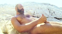 Gay bear Tom Neris is out at the lake pumping his joint up and down