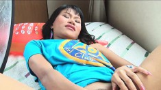 Alluring Asian Chick Ling Ling Exposes Her Narrow Snatch On The Sofa