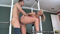 Phoenix Marie rides her personal trainer's cock in the weight room