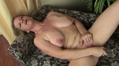 Horny blonde MILF opens her legs to fondle her soaking pussy