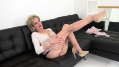 Mature blonde temptress shows her enormous rack and hot pussy in erotic film shoot