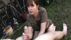Naughty babe Dee Delmar puts her hands to work on a big shaft outside