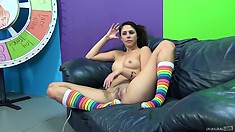 Anna sits on the couch relishing the hot sex encounter and caressing her snatch