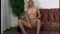 Seductive blonde with perfect tits Katina drops her sexy black dress and pleases herself