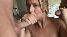 Eager blonde cocksucker gets on her knees and gobbles down two dicks
