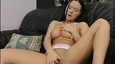 Lonely and lustful, a dazzling brunette milf masturbates on the couch