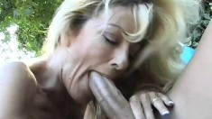 Buxom blonde mom seizes the chance to have fun with a young guy outside