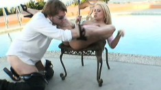 Kinky blonde Rebecca Steel gets banged by the side of the pool