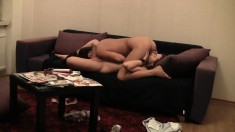 Lesbian couple go for some nasty, excited pussy licking on the couch