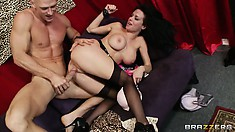 Dark-haired vixen spreads her nylon-clad legs and gets both holes licked