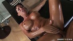 Huge, oily ass of cute brunette is getting a very hard banging