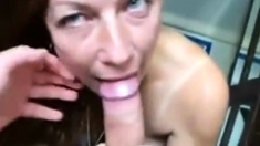 Brunette mature slut sucking a big hard cock on video
