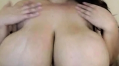 Sexy brunette Gianna Michaels oiling her big ass and boobs