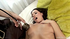 Sexy slender brunette with perky tits Stella lies on the bed and a guy pumps her cunt