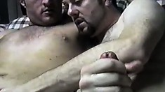 Hunky gay guy's masturbating session ends with him getting a blowjob