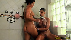 Cute brunette roommates like to save water and shower together
